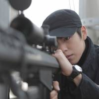 Love thy enemy: A slew of recent South Korean films portraying spies from the rival North — including this year's hit movie 'Secretly, Greatly,' starring Lee Hyun-woo — have been embraced by young South Koreans, who have no memory of the Korean War. | AFP-JIJI