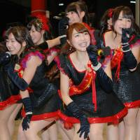 Working it: Nagoya idol group OS☆U performing a 'street live.' Being a rojō aidoru (street idol) is seen as a necessary step for many wannabes seeking to be discovered. | KYODO
