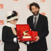 Yes: Yoko Ono receives the Venice Biennale's Golden Lion Award for Lifetime Achievement from Venice mayor Massimo Cacciari above); below: One of Ono's instruction pieces from 1963, 'Fly Piece' | VENICE BIENNALE