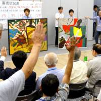 Art by democracy: Members of Nikaten, one of Japan's oldest competitive art exhibitions, vote on some of this year's entries for the show. | YOSHIAKI MIURA PHOTO