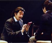 Russian realism: Hiroshi Abe as Alexander Herzen, 'the father of Russian Socialism,' hands his book 'From the Other Shore' to his son Sasha played by Jun Sakaguchi, in 'The Coast of Utopia' by Tom Stoppard. | ©MASAHIKO YAKOU
