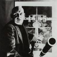 Designer couple: Alexsandr Rodchenko (above) with his poster for the film 'Battleship Potemkin,' and Varvara Stepanova in a dress made from fabric printed with her textile design. | THE STATE PUSHKIN MUSEUM / PRIVATE COLLECTION
