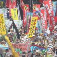 The disappointed: Protesters take part in an anti-nuclear rally in Yoyogi Park, Tokyo, on July 16, 2012. | BLOOMBERG