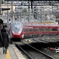 'For a more united Italy': A high-speed train operated by Nuovo Trasporto Viaggiatori SpA (NTV) departs on its inaugural run for Naples from Tiburtina Station in Rome on April 20, 2012. NTV is competing with Trenitalia SpA, a subsidiary of state-owned Ferrovie dello Stato, for the high-speed line from Milan and Naples to Rome. | BLOOMBERG