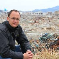 On location: Tokyo-based Australian journalist Mark Willacy, author of 'Fukushima' (published 2013 by Macmillan Australia), visits the devastated coastal town of Rikuzentakata, Iwate Prefecture, in March 2011.   COURTESY OF MARK WILLACY