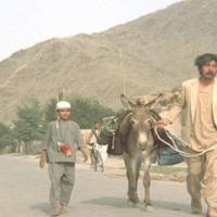 Portrait of the documentarian: Actor Rentaro Mikuni walks with an Afghan boy, who he knew only as Nabi, in a scene from his uncompleted 1972 film 'Kishi no nai kawa' (The Endless Stream).