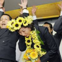 In bloom: Politician Seiko Noda, pictured here after winning her seat in Japan's House of Representatives in August 2009, hopes her unusual pregnancy will help provoke a discussion about the availability of infertility treatments in Japan. | KYODO PHOTO