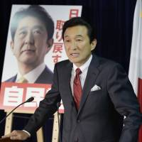 In the running: Upper House LDP candidate Miki Watanabe campaigns in Tokyo. He has been accused by the media for 'black' business practices. | KYODO