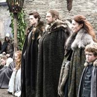 Wolf pack: Ned Stark (Sean Bean, third from right) with his wife Catelyn (Michelle Fairley, beside him) and the rest of the Stark clan in a scene from the first season of the epic fantasy drama 'Game of Thrones.' © 2013 Home Box Office, Inc. | ALL RIGHTS RESERVED.