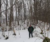 Snow man: Old Nic stands on new land recently acquired to boost the area of the Afan Woodland Trust in Nagano Prefecture. | MR. ISHII