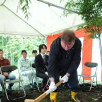 Easy does it: Old Nic placates the gods in a ceremony before the construction of a clubhouse in The C.W. Nicol Afan Woodland Trust.   KENJI MINAMI PHOTO
