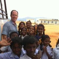 Warm welcome: The author with village kids drawn to the outsider on their patch.