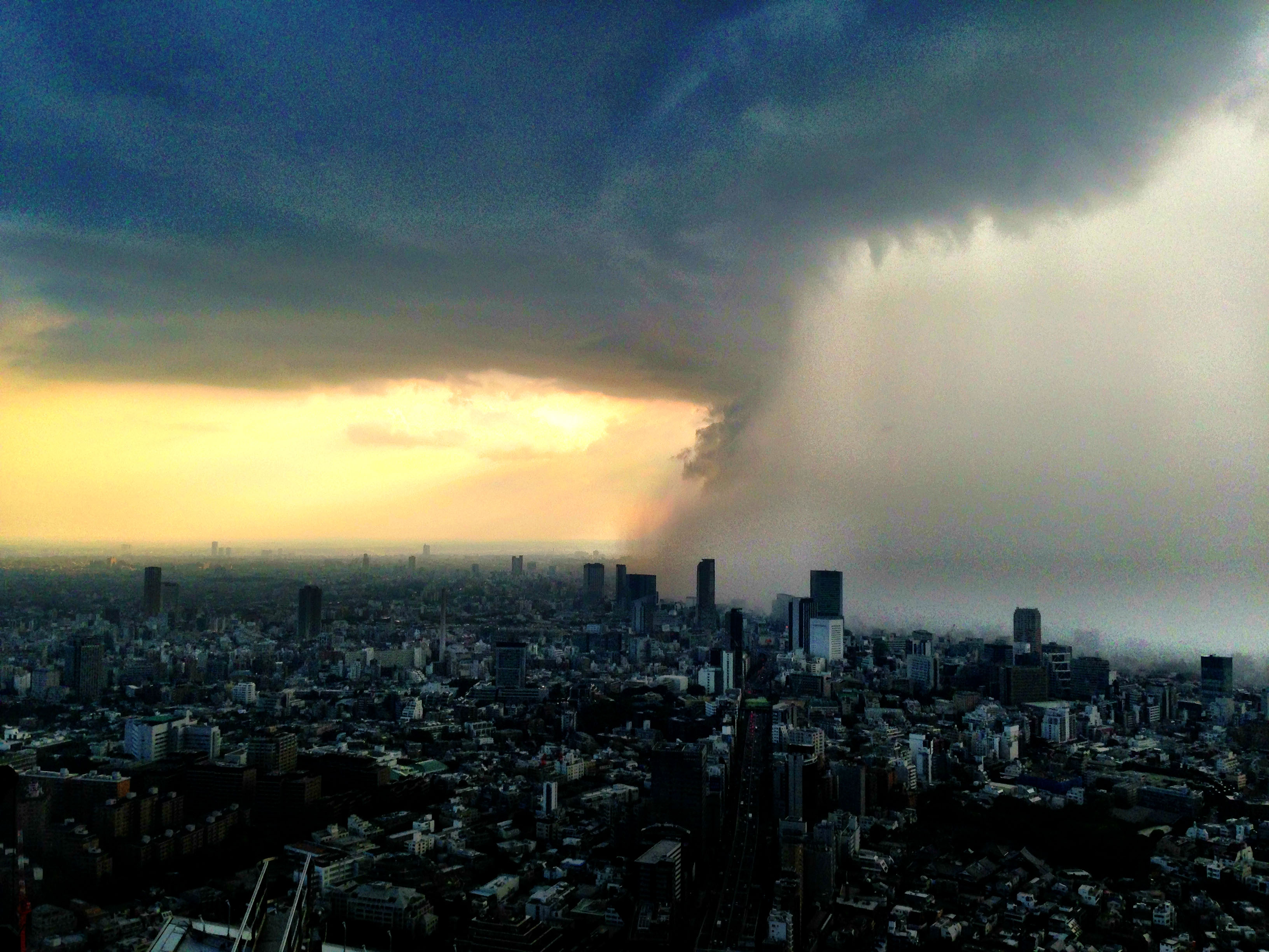 Run for cover: As summer kicked in last week, so did Tokyo's heat-island effect, which caused this picturesque 'guerrilla storm' as seen from Roppongi Hills. | JAKE ADELSTEIN