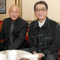 Anticipation: Director Yojiro Takita (right) sits with producer Yasuhiro Mase. The director declined to speculate on his chances of winning a Best Foreign Language Film Oscar. | YOSHIAKI MIURA PHOTO