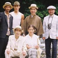 Note perfect: The cast of 'Nisesatsu,' including Mitsuko Baisho (front right) and Yuichi Kimura (back, far right) | © 2009 'NISESATSU' SEISAKU IINKAI