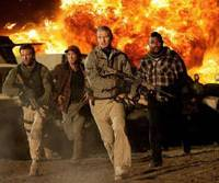 On the run: The A-Team — played by (from left to right) Bradley Cooper, Sharlto Copley, Liam Neeson and Quinton 'Rampage' Jackson — flee from one of the film's many awesome explosions. | © 2010 TWENTIETH CENTURY FOX