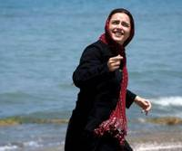 Threadbare: Schoolteacher Elly (Taraneh Alidoosti) flies a kite at a seaside resort near Tehran, where she's staying with old friends, in 'About Elly.' But how genuine is her smile? | © 2009 SIMAYE MEHR.