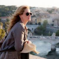 Self service: Liz (Julia Roberts) drinks in the Italian scenery in 'Eat Pray Love,' after leaving her life behind in an attempt to 'find herself.'
