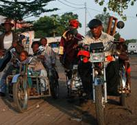 Congolesey rider: Members of the band Staff Benda Bilili, many of whom are disabled, ride wheelchairs styled as motorbikes.