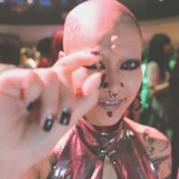 Transparent fish and chips: In 'GFP Bunny' — Yutaka Tsuchiya's exploration of surveillance, identity and biotech — body-modification artist Takahashi goes beyond tattoos and piercings and implants an IC chip in her hand to monitor herself. | ©W-TV OFFICE