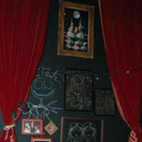 Artwork by sometime patron Tim Burton adorns the wall of Sumire no Tenmado in Golden Gai.