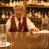 Correct recommendations: Owner Hiroshi Oizumi stands behind the bar at Correos, a fun spot that complements Shibuya's easygoing ways. | WILL ROBB PHOTOS