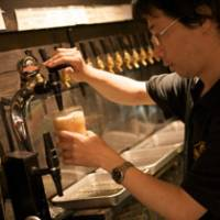 Best beers and weird beverages: Hiroyuki Hanaka pulls a pint at The Aldgate.