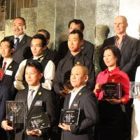 Winner of the Diageo World Class Japan Final Tsuyoshi Miyazaki stands front, center, surrounded by other prize winners at the national cocktail competition.   DRINK PLANET