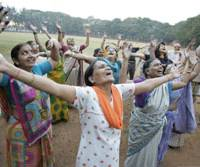 Indian practitioners of Laughter Yoga let their mood-enhancing endorphins loose during a session in Mumbai. | PHOTO COURTESY OF LAUGHTER YOGA INTERNATIONAL/ www.laughteryoga.org