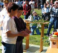 Activists Mary Kitagawa and Rose Murakami (right) clap during the garden's ground-breaking ceremony | BRIAN SMALLSHAW PHOTO