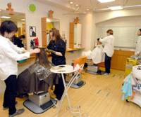 The Hair Resort Clips salon in western Tokyo (left); one of Hideki Sato's daily notes of a customer's styling, complete with precise hair-length measurements; and the man himself at work on one of his flat- top tonsorial creations.   YOSHIAKI MIURA PHOTOS