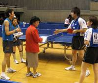 Naomi Yotsumoto and Masato Watanabe square up with Ai Fukuhara and Ryusuke Sakamoto (top) at last month's Table Tennis National Championships in Tokyo; after the match (above); and preparing to return serve.   EDAN CORKILL PHOTOS