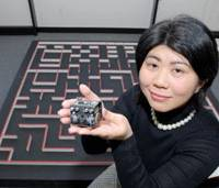 RT Corporation CEO Yukiko Nakagawa holds Pi:Co, a robot that can make its way through mazes, and which her company will put on the market in June. | YOSHIAKI MIURA PHOTO