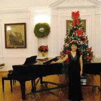 Multitalented: Mitsuru Claire Chino is also a classically trained singer and performs semi-professionally. Here she poses by the grand piano at a concert at Yale University in 2007. | PHOTO COURTESY OF MITSURU CLAIRE CHINO