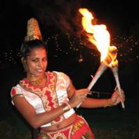 Warm welcome: Sri Lankan AUW student Ishara Piumi Warakagoda performs a traditional fire dance as a happy greeting to visitors to the campus. Although her parents' business was burned down during ethnic violence, she has traveled in many parts of her homeland most affected by the civil war in a 'peace-through-art' initiative, and aims to continue working toward ending the bloodshed that plagues Sri Lanka.   JEFF KINGSTON PHOTO