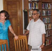 Show of support: Kamal Ahmad, whose idea AUW was, shows the library to Kathy Pike, Assistant Dean of Research at Temple University, Japan Campus.   JEFF KINGSTON PHOTO