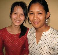 High achievers: Two of the eight Cambodian students currently at AUW whose English skills were at first rather weak, but who now speak the language excellently, give PowerPoint presentations and engage in debate. | JEFF KINGSTON PHOTO