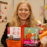 Word of advice: Entrepreneur Natalia Roschina proudly displays the two books she penned on how to resolve the Japanese recession.   KARRYN MILLER PHOTO