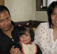 Living in fear: Hla Aye with his wife and daughter in their central Tokyo apartment where he constantly lives in fear of forcible deportation. | JEFF KINGSTON
