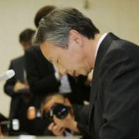 Deep feelings: Kiyoya Kawada, an obstetrician at Kagawa Prefectural Central Hospital in Takamatsu, Kagawa Prefecture, bows Feb. 27, 2009 as he apologizes for having implanted a woman with a fertilized egg from another patient. | KYODO PHOTO
