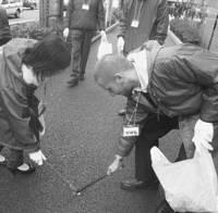 Akiba beautiful: Japanese and non-Japanese worked side by side to help rid Tokyo's Akihabara of litter. Participants, who had largely gathered in response to Web site notices and posters hung in student dormitories, filled out questionnaires and received free bottles of green tea after their work was done.