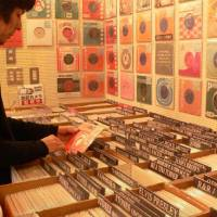 Vinyl heaven: A treasure-hunter fingers 7-inch gems at Be-in in Tokyo's Koenji district.