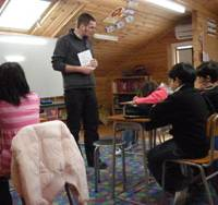 World support: Marcus Nikkarinen, a Canadian teacher and one of the four full-time teachers at Tsukuba International School, teaches math to Japanese and foreign pupils at a makeshift classroom in the former building. Two more full-time foreign teachers are to join the school soon.   KEISUKE OKADA PHOTO