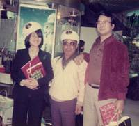 Taking a break: Miyazaki (right) at a Hong Kong souvenir shop with an employee of his company and the man's daughter in the late 1970s | MANABU MIYAZAKI