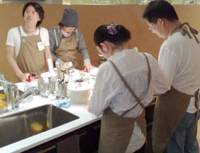 Recipe for success: Men mix it with their female counterparts at the +m Marunouchi Studio cooking school in Tokyo. | EDAN CORKILL