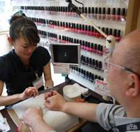 Digital delight: A man receives a personalized nail health and beauty treatment from one of the specialists at the Omotesando, central Tokyo, branch of nail-salon chain Nail Quick. | TOMOKO OTAKE