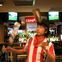 Gone to his head: Keisuke Goto serves up a stunt at TGI Friday's. | WILL ROBB