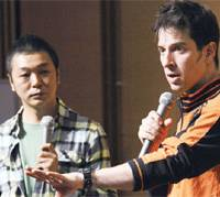 Famed stand-up comedian Patrick Harlan (right), who she represented and is seen here at an event in Tokyo in April.