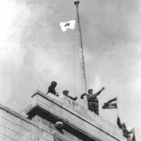 Sun rising: Japanese soldiers raise their country's  Hinomaru  sun flag atop a building in Nanjing, China, in December 1937. | AP PHOTO