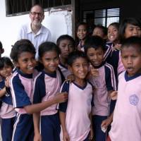 Jim Wagner poses with children on a recent trip to Kubang, Indonesia. His organization, cofounded with Dede Prabowo, helping sponsor Indonesian children so they can go to school. | PHOTOS COURTESY OF JIM WAGNER AND DEDE PRABOWO